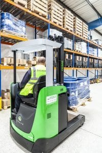 Stacker trucks working in a warehouse